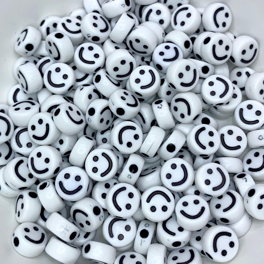 miçanga smile emoji branco e preto 10x5mm 25 unidades