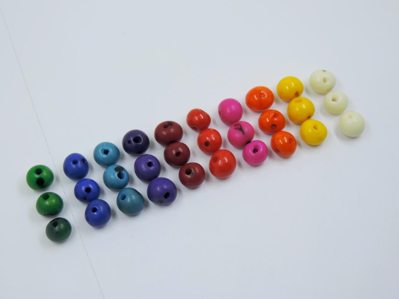 semente de açaí com furo colorido 100 unidades