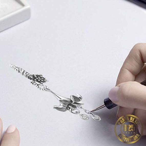 Berloque Flor de Lis de Prata