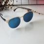 Óculos redondo espelhado azul feminino