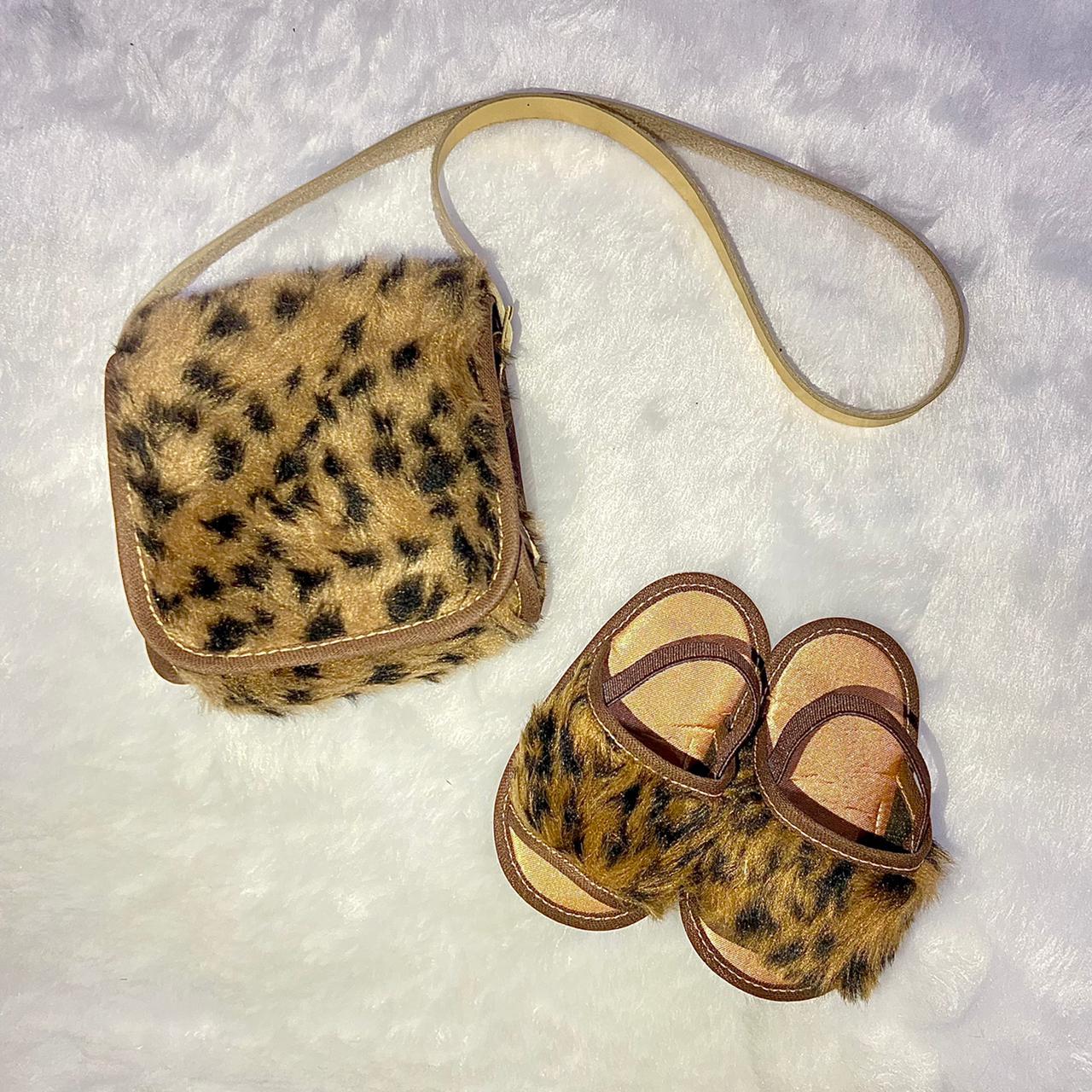 Bolsa Clutch Bebê em Pelúcia Onça