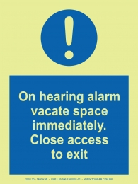 On hearing alarm vacate space immediately. Close access to exit