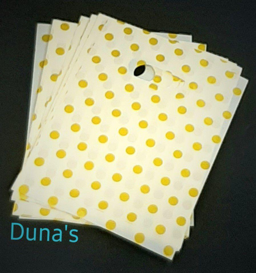 Sacola plástica 15x20 amarela com poá dourado