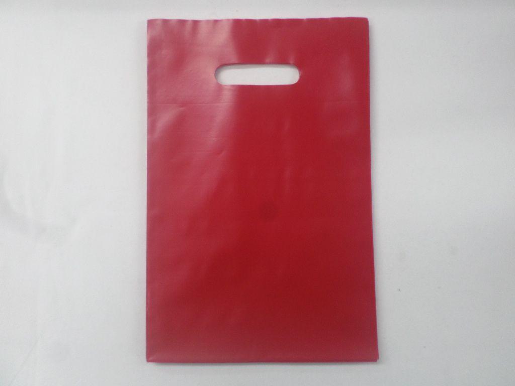 Sacola Plástica 20X30 VERMELHO ( pacote com 25 unidades ) alça boca de palhaço