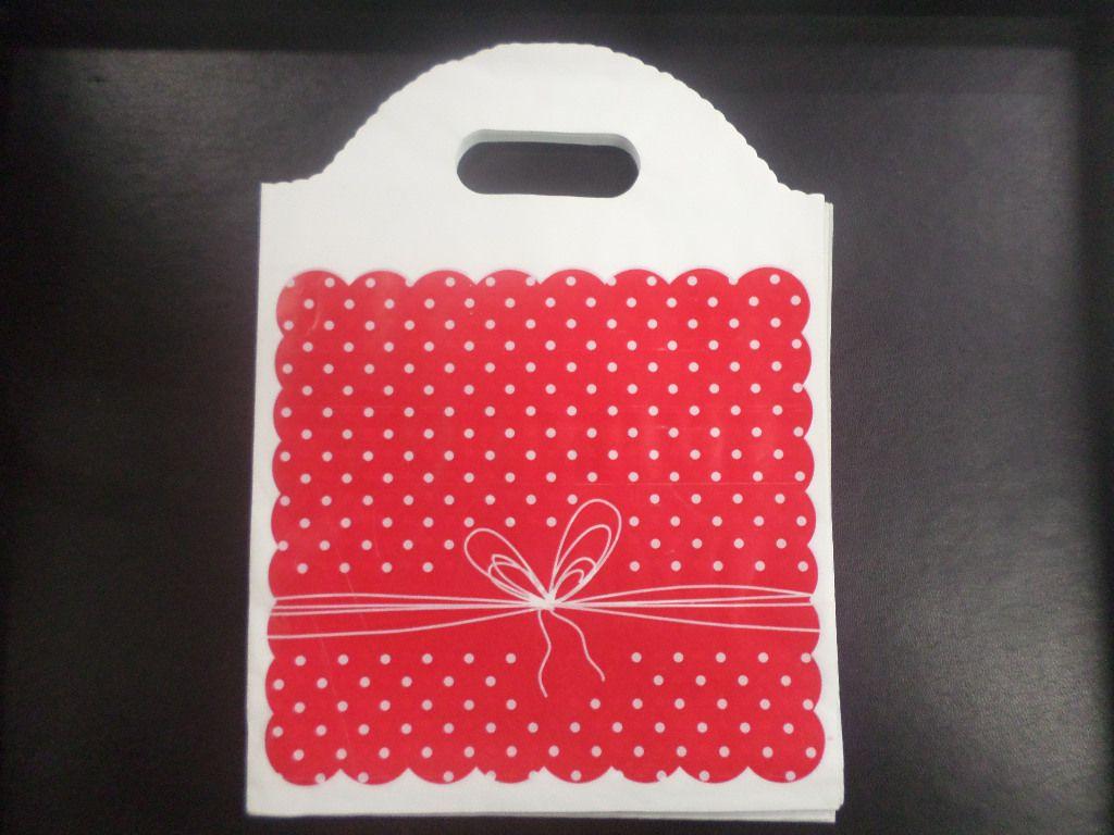 Sacola Plástica ( vermelho poá/laço peq ) 18x24 pacote com 50 unidades