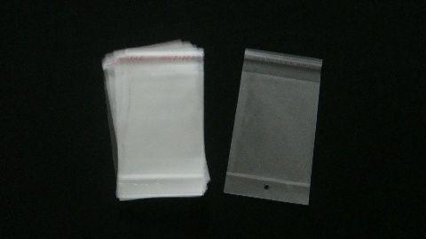 Saquinho plástico adesivado 10x15 com furo pacote com 100 unidades