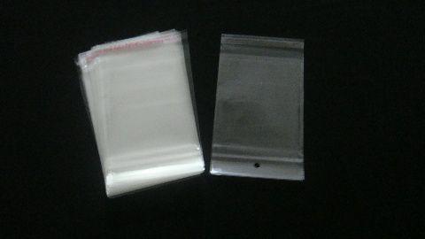 Saquinho plástico adesivado 12x15 com furo pacote com 1000 unidades