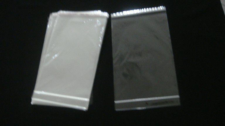 Saquinho plástico adesivado 18x25 com furo pacote com 100 unidades