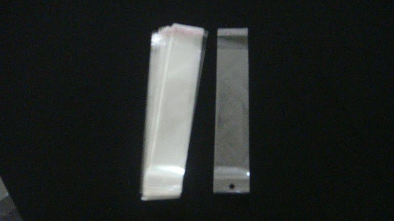 Saquinho plástico adesivado 5x22 com furo pacote com 100 unidades