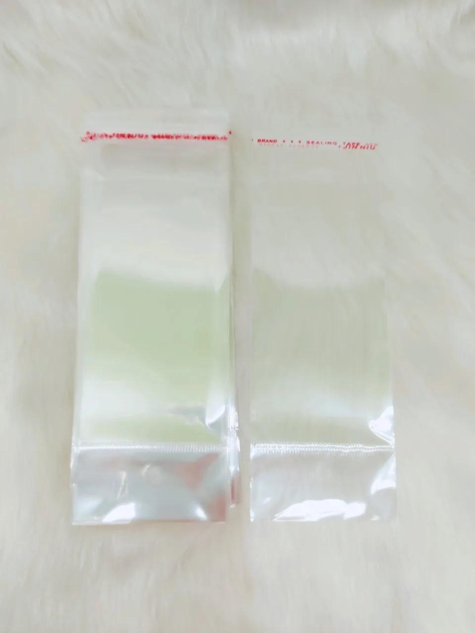 Saquinho plástico adesivado 6x12 com furo pacote com 100 unidades