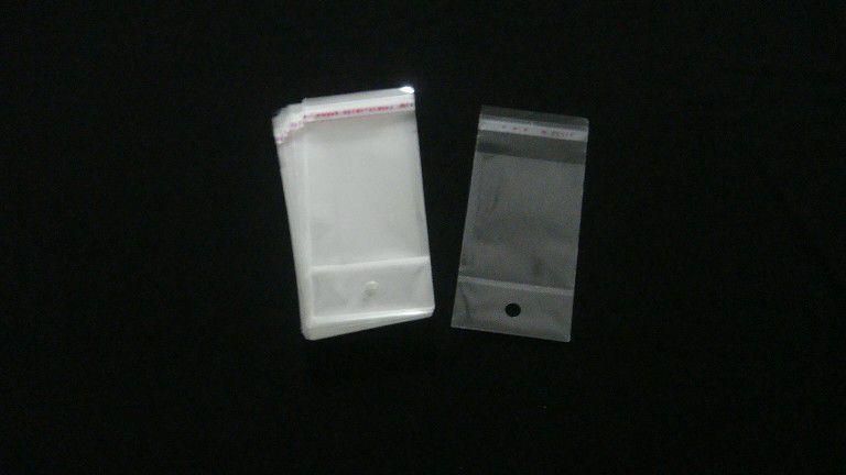 Saquinho plástico adesivado 6x7 com furo pacote com 100 unidades