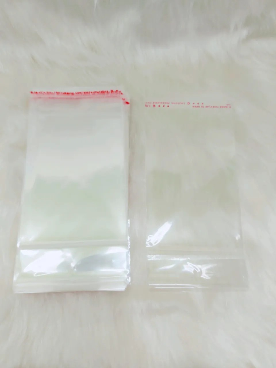 Saquinho plástico adesivado 9x13 com furo pacote com 1000 unidades