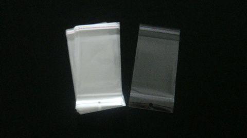 Saquinho plástico adesivado 9x13 com furo pacote com 100 unidades