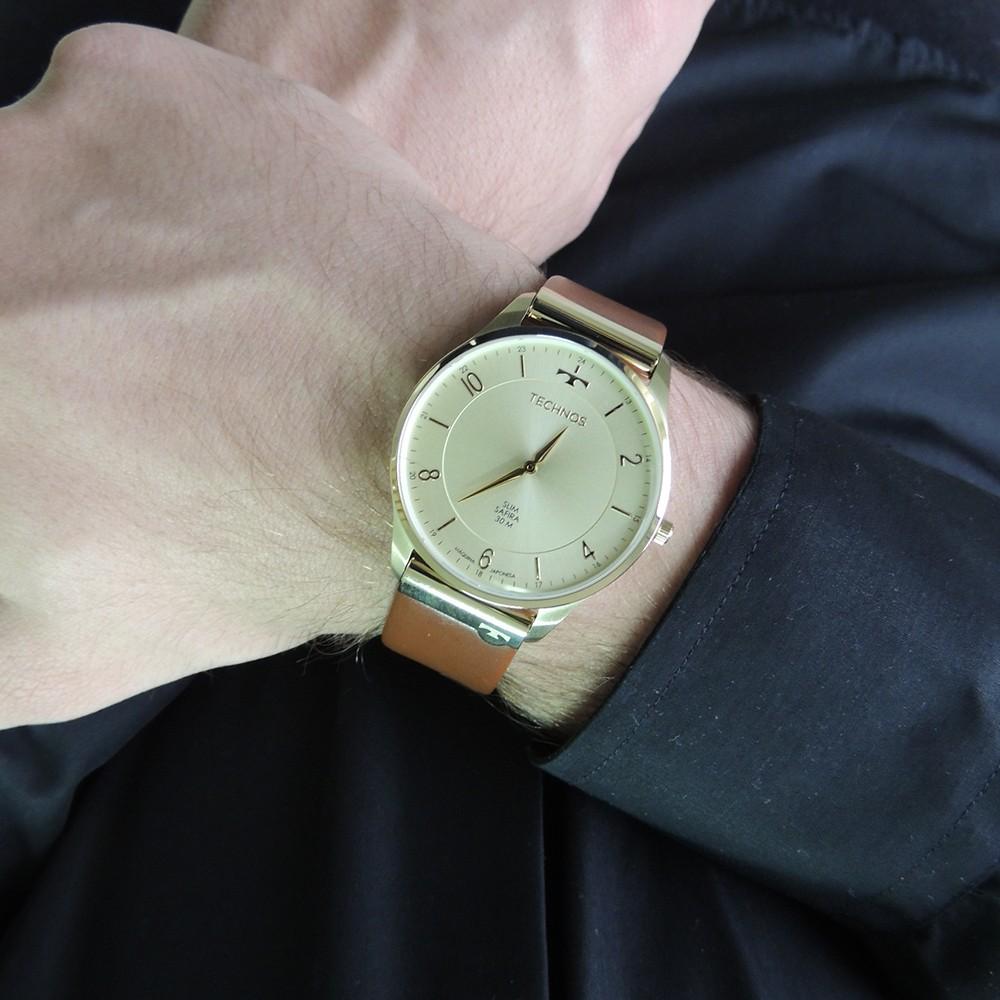 Relógio Technos Dourado Clássico Classic Slim Fino Cristal Safira Pulseira de Couro Marrom 9T22AJ/2X