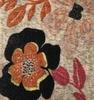 Estampado floral com flores pretas com laranja