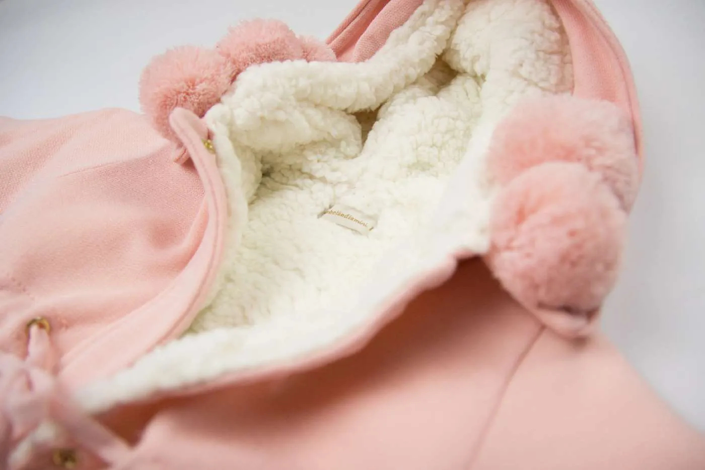 Casaco Pompom Bebelândia