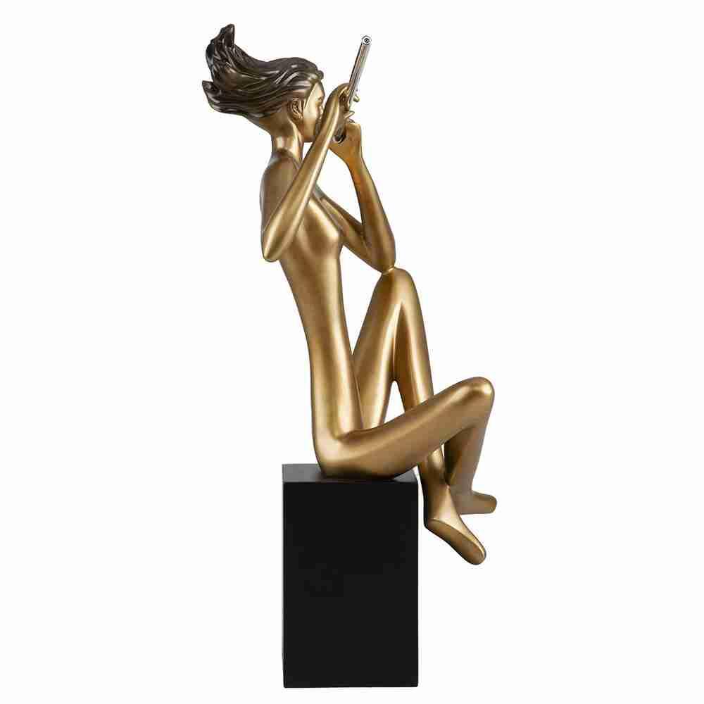 Escultura Flautista Dourada