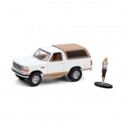 Miniatura Ford Bronco 1996 Eddie Bauer with Backpacker 1/64 Greenlight