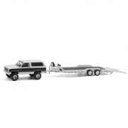 Miniatura GMC Jimmy Sierra 1983 com Prancha Hitch & Tow 1/64 Greenlight