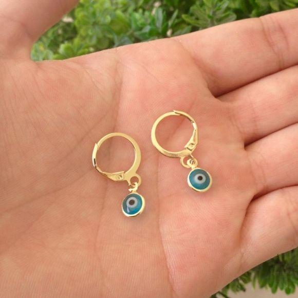 Brinco olho grego azul claro banhada a ouro