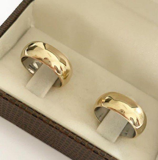 Par de aliança 7mm abaulada aço com a capa de ouro 18k