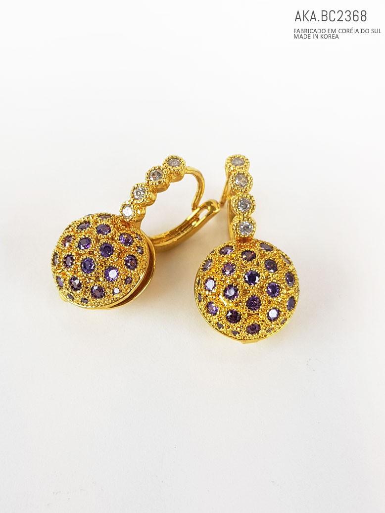 Brinco de pressão dourado com pedra imitando  cristal lilás - AKA-BC 2368