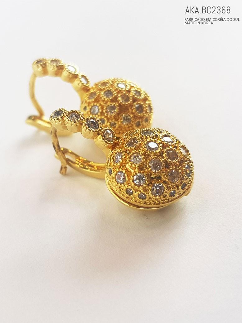 Brinco de furo cristais dourado