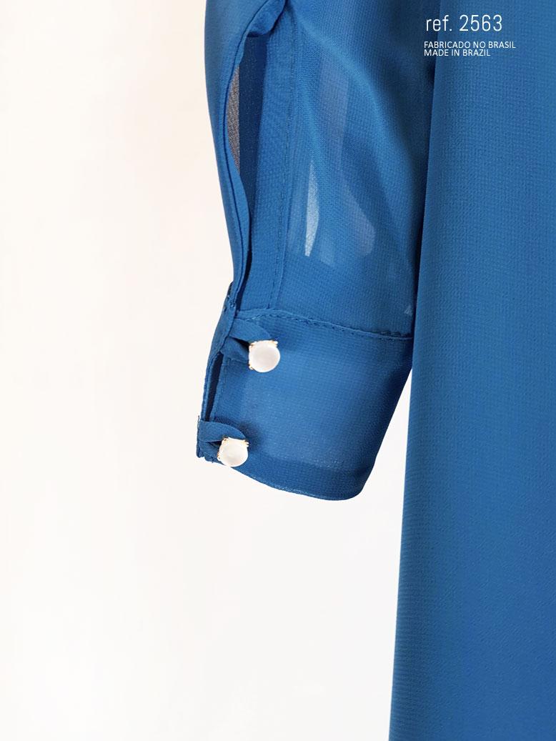 botões do punho do vestido azul petroleo