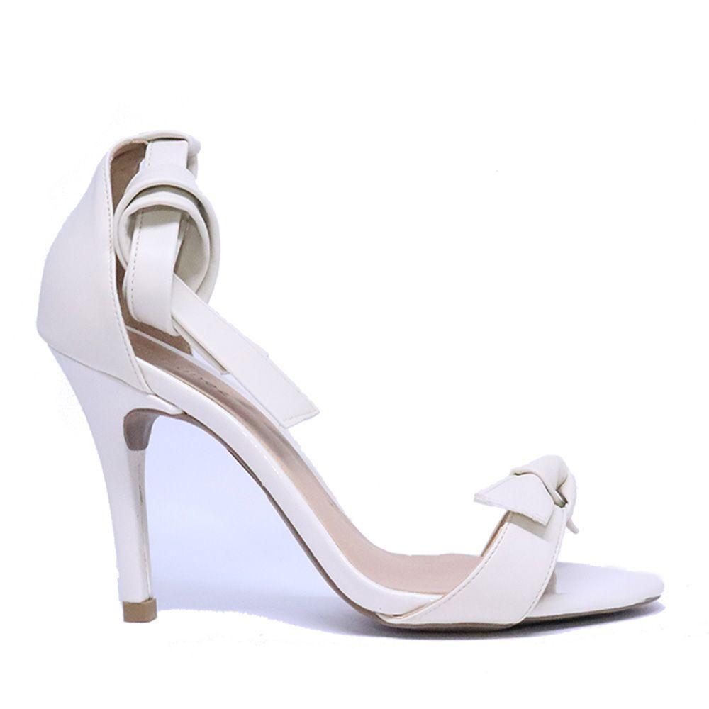 Sandália salto fino tira frente tira com nó porcelana