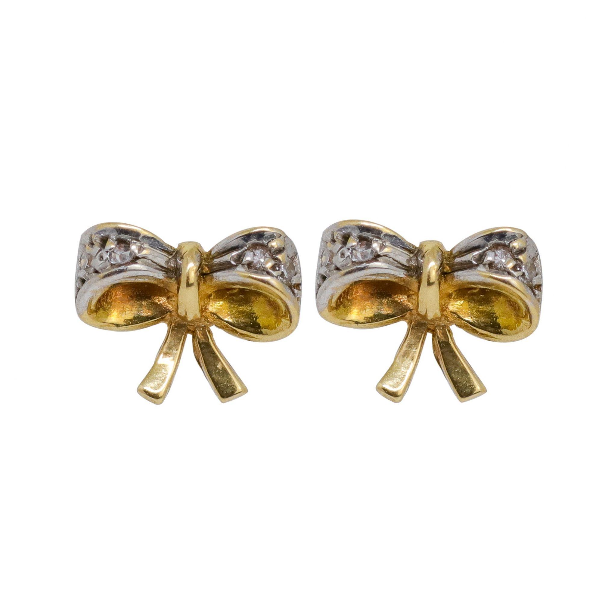 Brinco ouro 18k laço com diamantes 0,5 pts