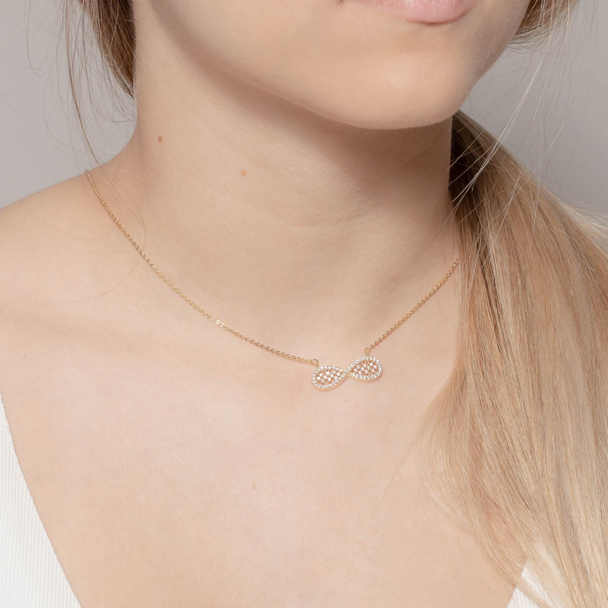 Colar com pendente infinito cravejado com micro zircônias banhado a ouro 18k.  - bfdecor.com.br
