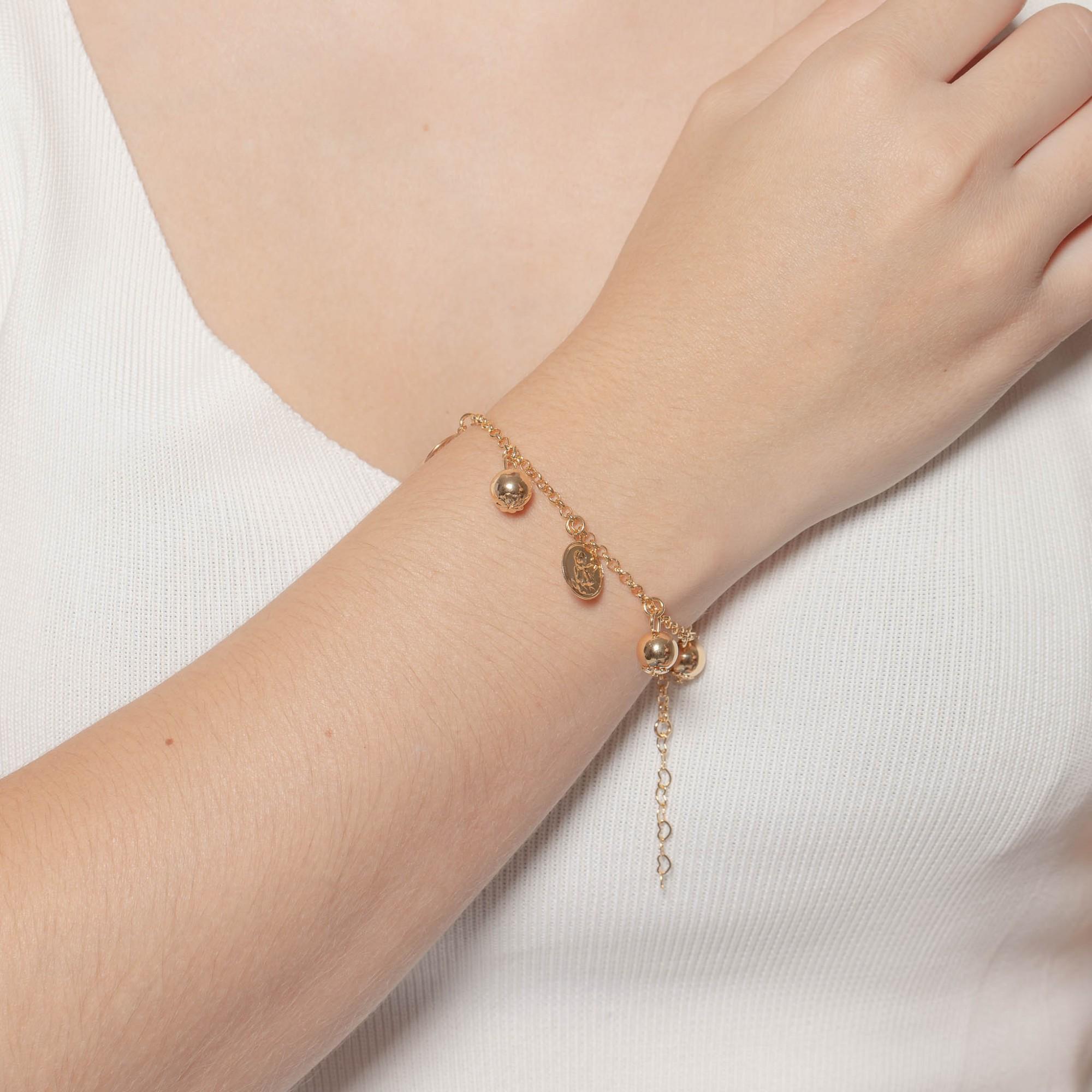 Pulseira com pendentes de bola e medalhas de anjo banhada a ouro 18k.  - romabrazil.com.br