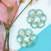 Brinco feminino em formato de flor com pedras azuis, Família Botânica