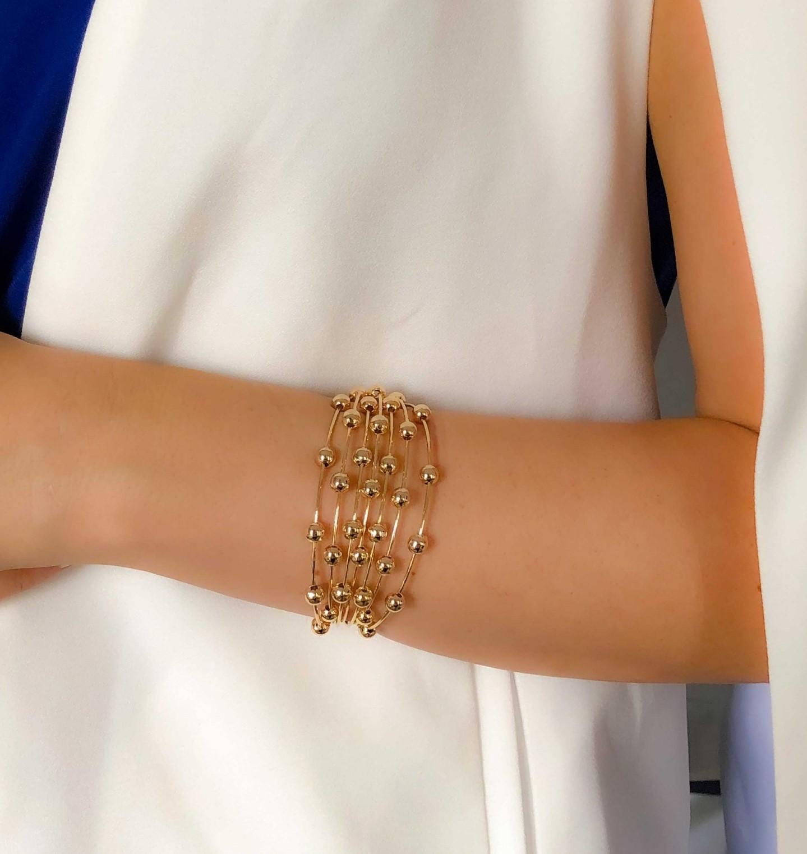 Bracelete bolinhas banhado a ouro 18k