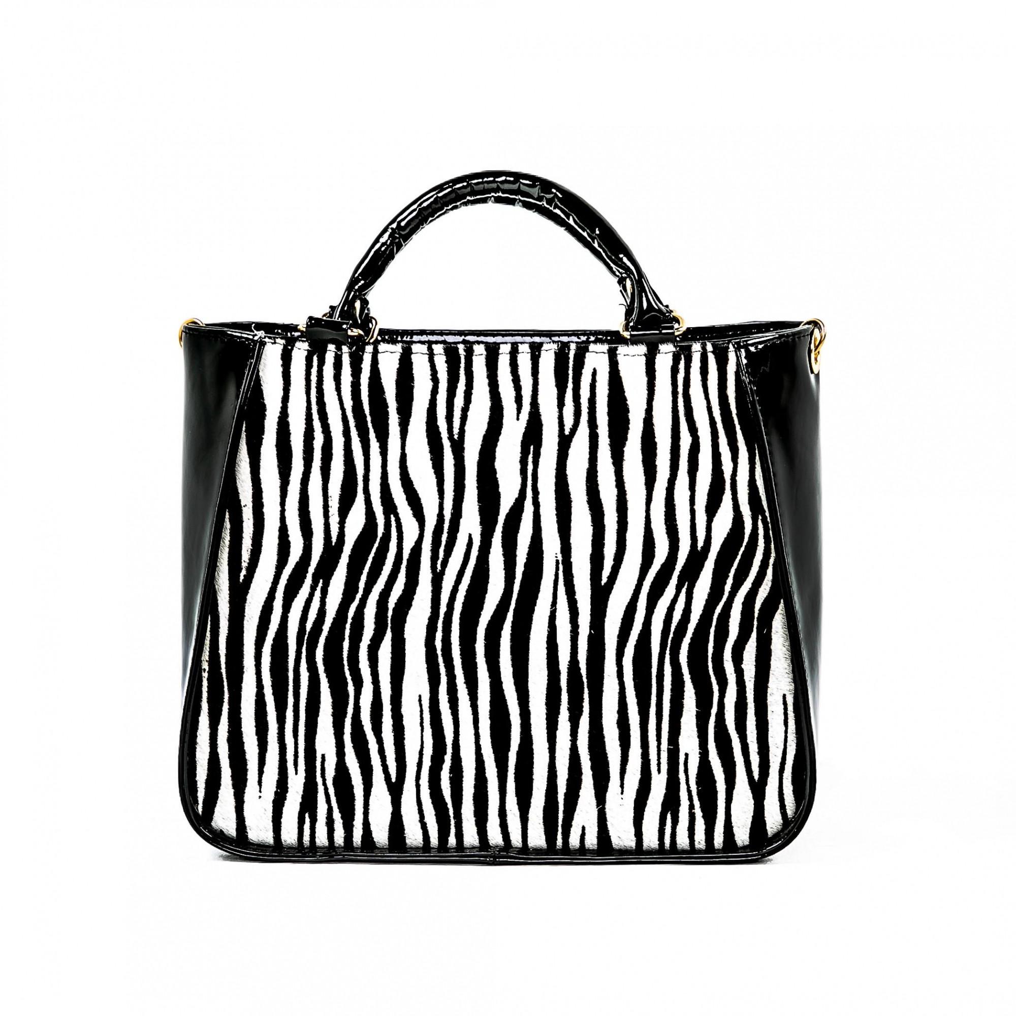 Bolsa verniz preta e pelo zebra