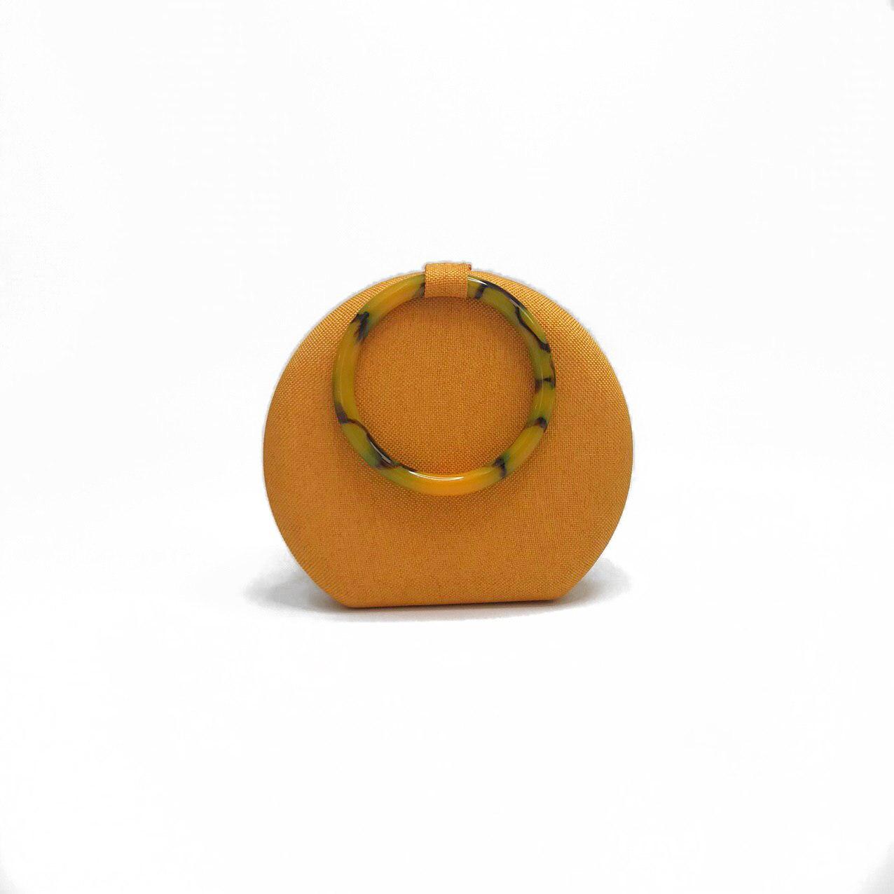 Bolsa feminina com alça redonda