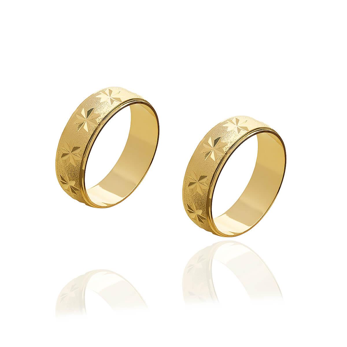 Par de aliancas de Ouro diamantadas e trabalhadas e 6 g