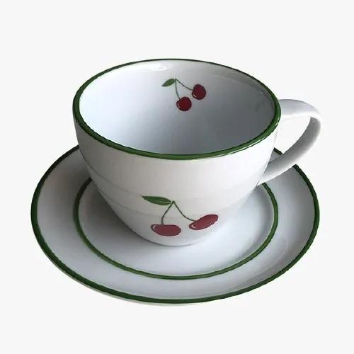 Xicara de Chá As cerejas