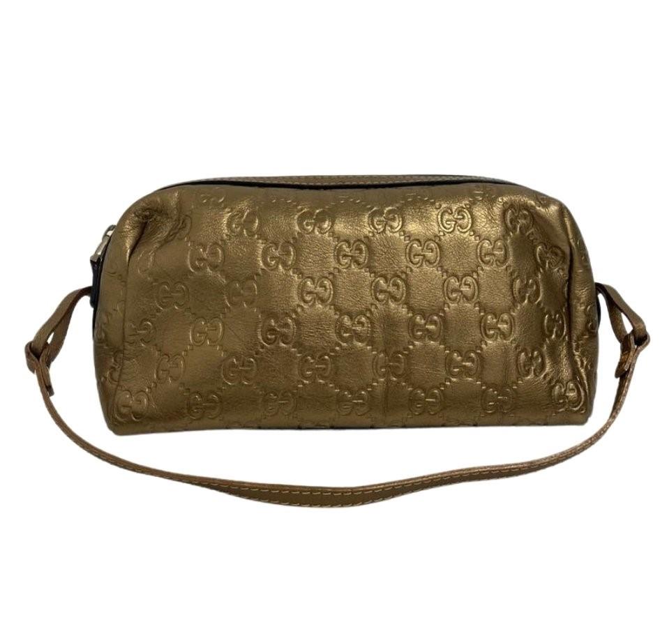 Bolsa Gucci GG Supreme Dourada