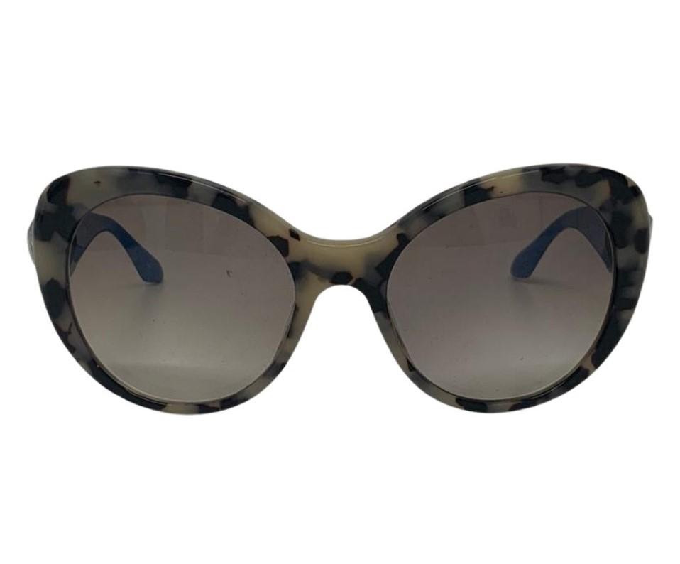 Óculos Prada com detalhe em Pedras