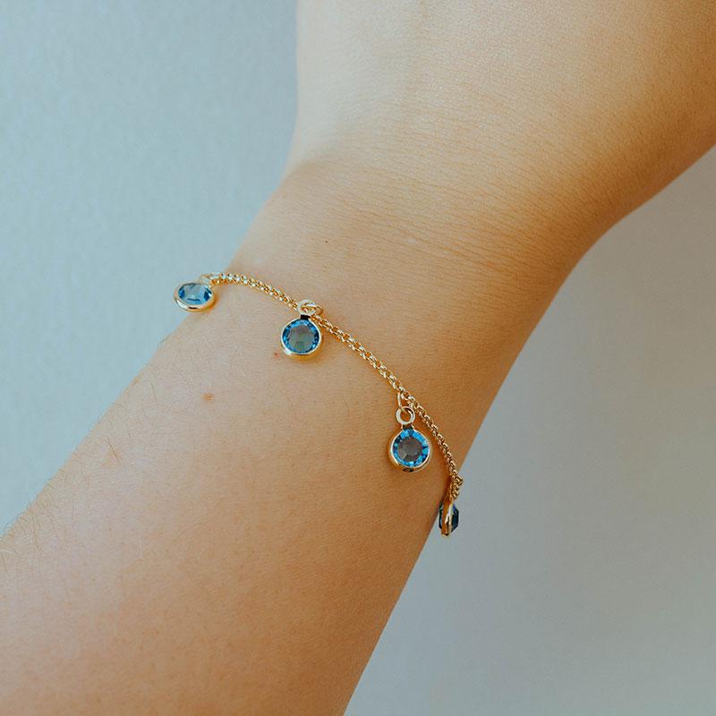 Pulseira com pedras azul claro banhado à ouro 18k feminino
