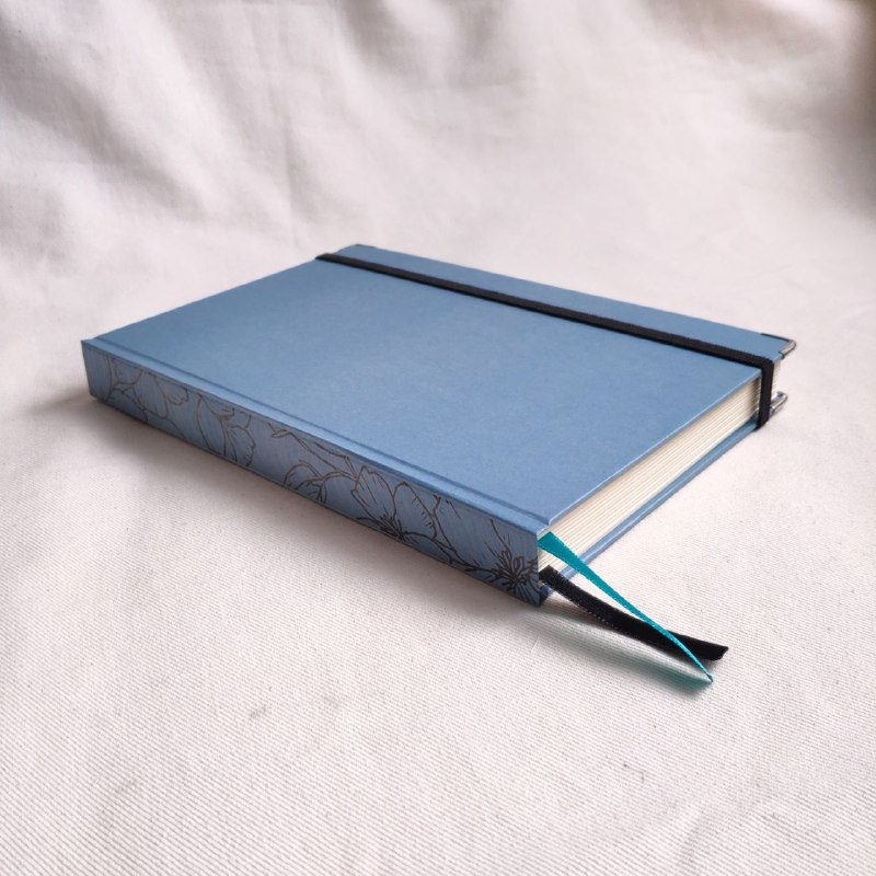 caderneta lombada florida azul 90g/m²