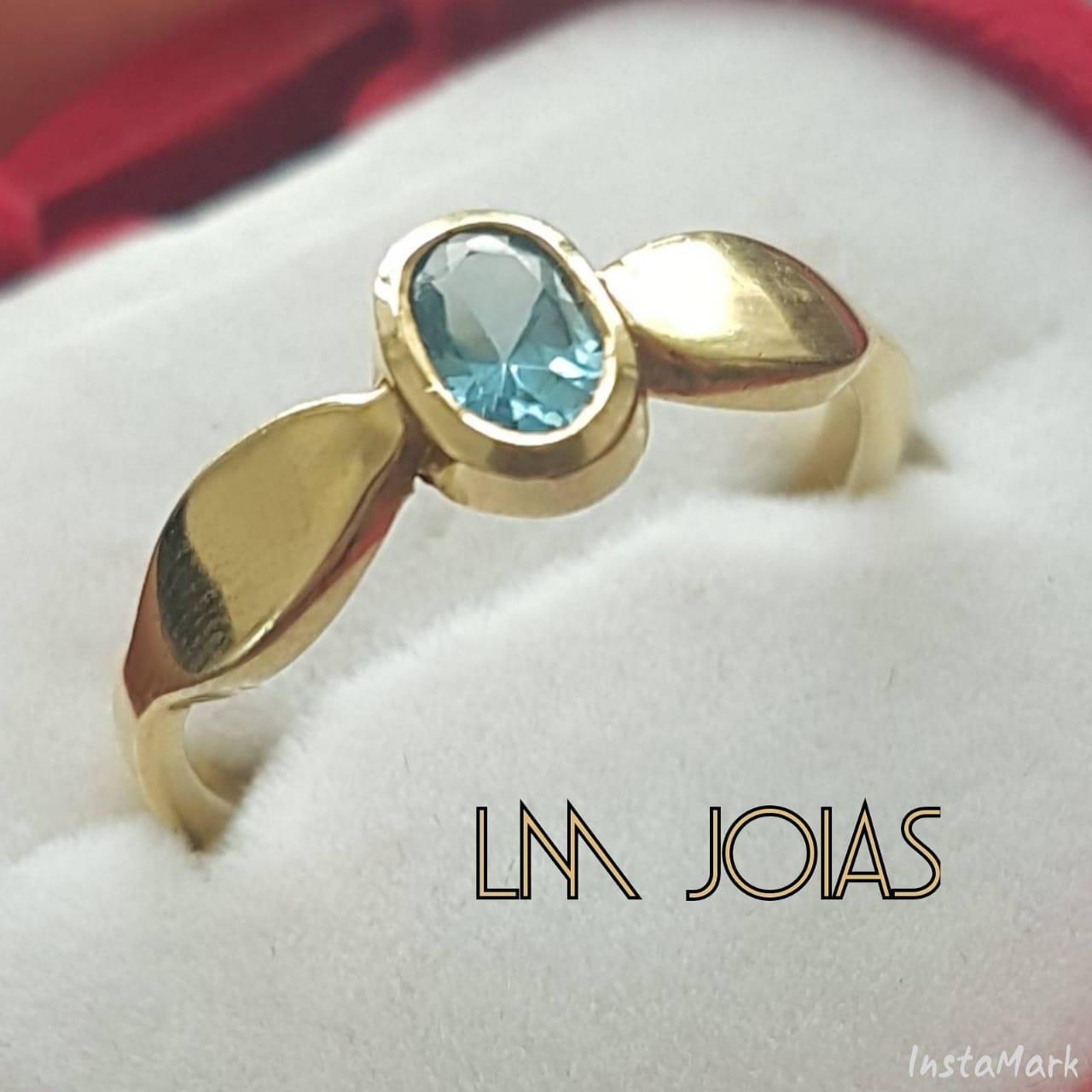 Anel aparador tiara com topázio azul em ouro 18k - A unidade feminina