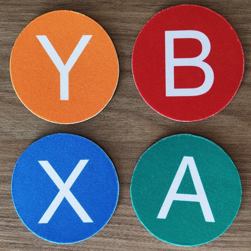 Jogo de Porta Copos Botões ABYX