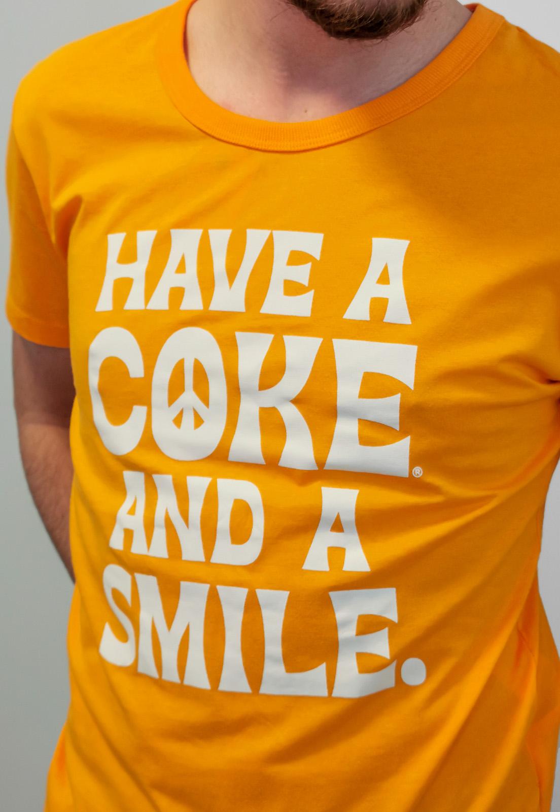 Camiseta Coca-Cola Laranja Smile
