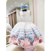 Vestido Petit Cherie branco com barrado floral e saia coberta com tule