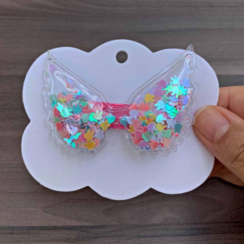 Laço Plástico Em Formato De Asa Com Flocos Coloridos