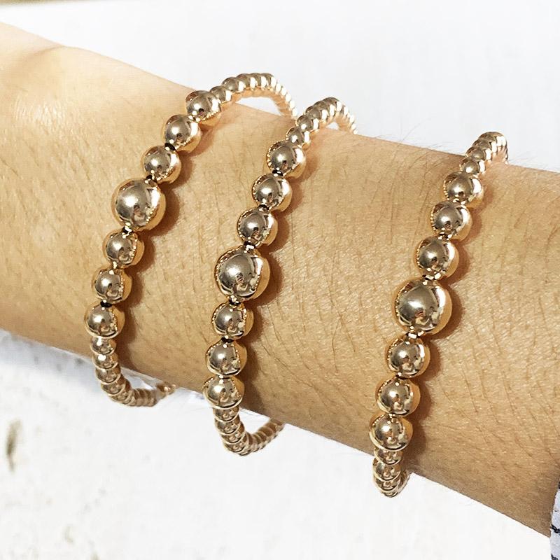 Bracelete Dourado com Bolas Médias Degrade