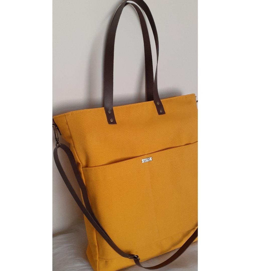 Bolsa amarela de tecido com alças de couro maccril