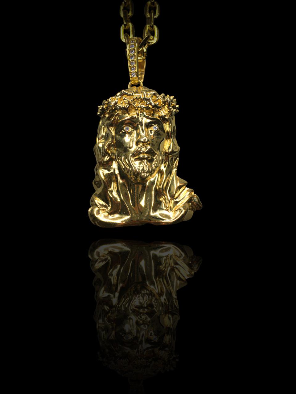 Pingente face de Jesus Cristo 3D - pedras cravejadas nos olhos  banhado a ouro 18k